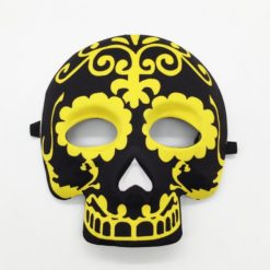 Mexico sugar skull with black background and bright yellow details.