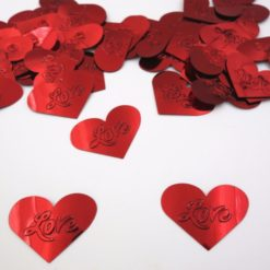 Red heart shaped conteffti with the word love on it