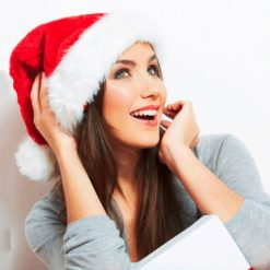 Red santa claus hat with white fluffy details.